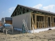 Economic wooden family house built from Ekopanely boards building system, turnkey project
